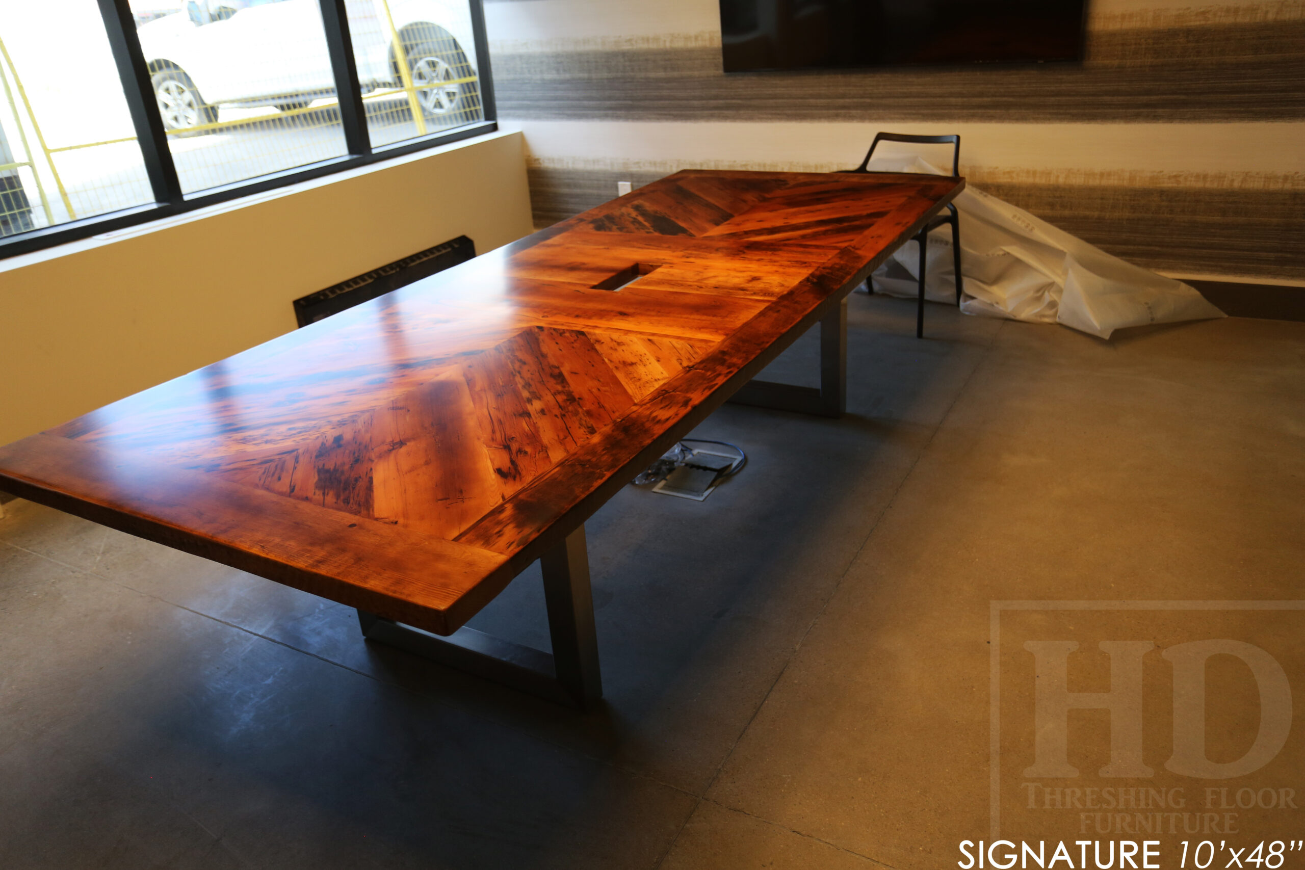 """10' Reclaimed wood boardroom table made for a Maple, ON company - 48"""" wide - Hemlock Threshing Floor Construction - Original edges & distressing maintained - Customized joinery - Premium epoxy + satin polyurethane finish - Stainless Steel Base - www.table.ca"""
