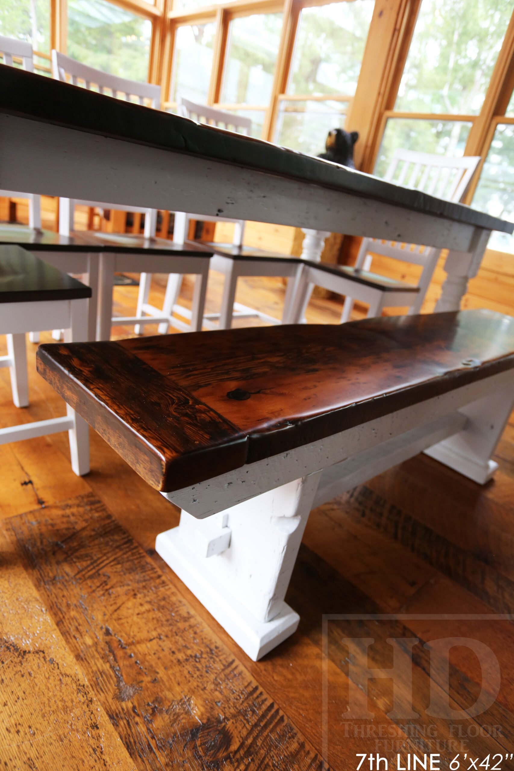 """Details: 6' Reclaimed Wood Table we made for an Ontario cottage - 42"""" wide - Harvest Base - Turned Windbrace Beam Legs [painted white] - Old Growth Hemlock Threshing Floor Construction - Original edges & distressing maintained - Premium epoxy + satin polyurethane finish - 5' Trestle Bench - 5 Hudson Chairs / Wormy Maple / White Frame + Seat stained colour of table - www.table.ca"""