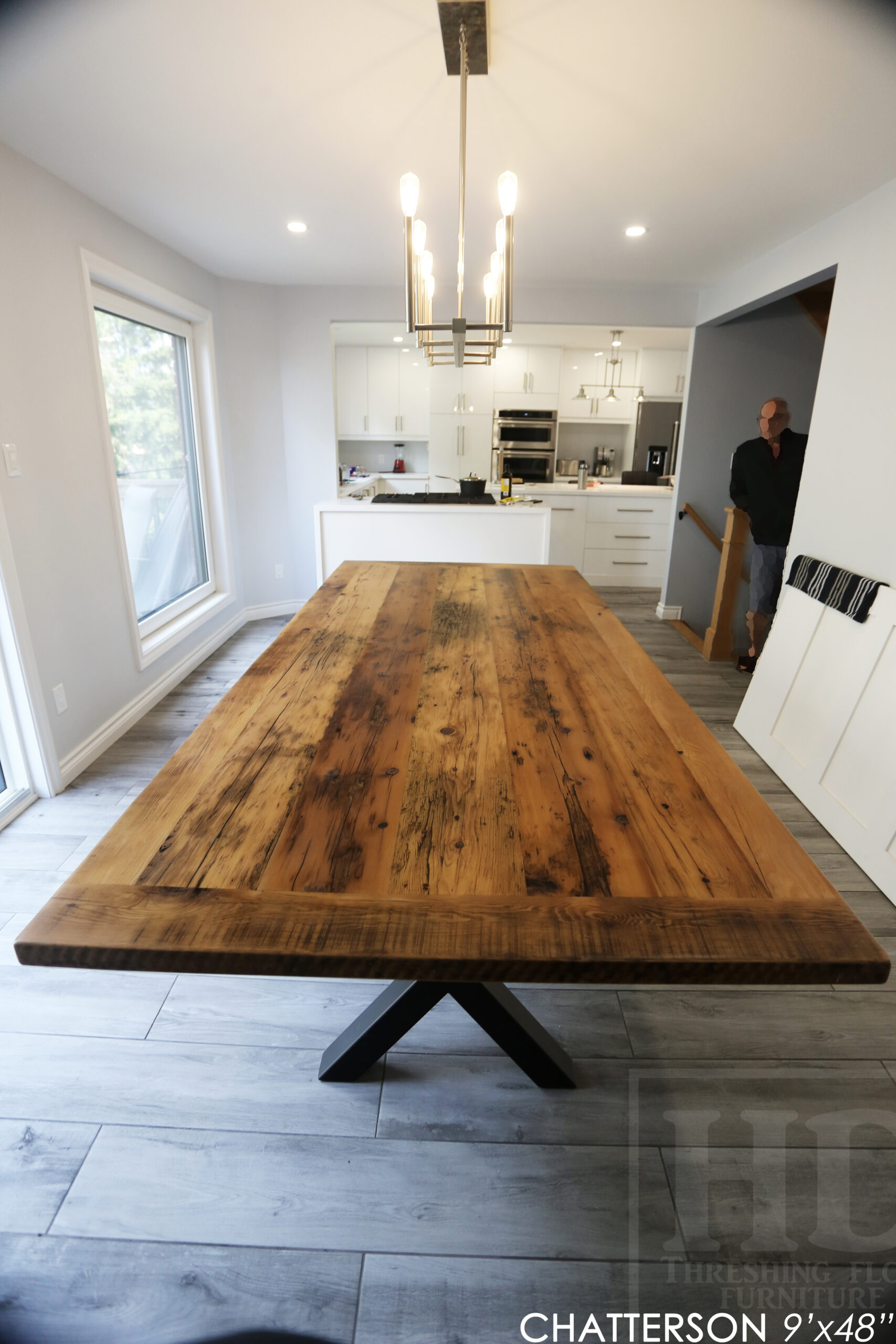 """9' Reclaimed Wood Table for an Ancaster home - 48"""" wide - Hemlock Threshing Floor 2"""" Barnwood Top - Black X Shaped Metal Base - Original edges & distressing maintained - Premium epoxy + matte polyurethane finish - Greytone Treatment Option to maintain colour of unfinished - www.table.ca"""