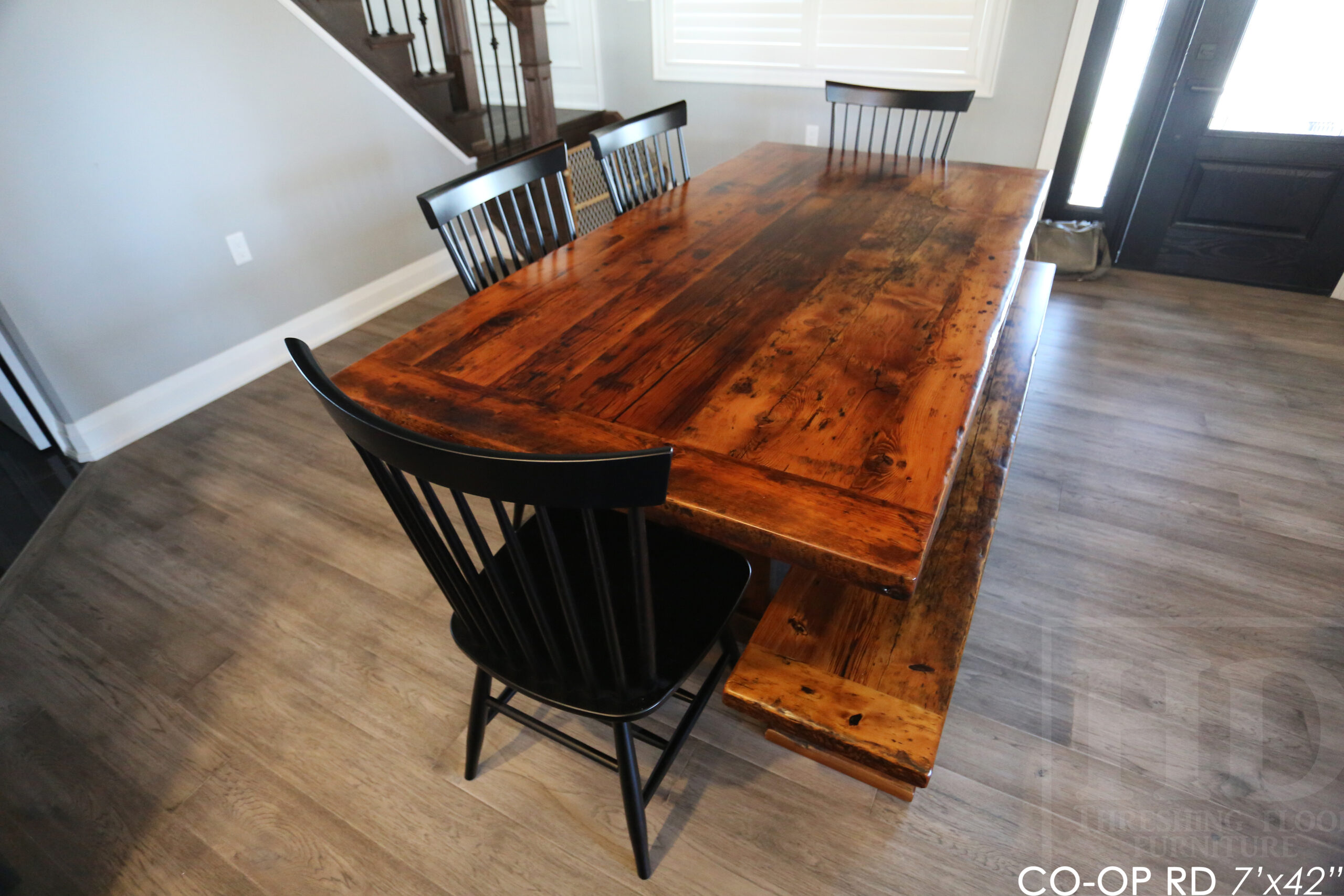 """Details: 7' Reclaimed Wood Table we made for an Orono home - 42"""" wide - Trestle Base - Hemlock Threshing Floor Construction - Original edges & distressing maintained - Premium epoxy + satin polyurethane finish - 7' Reclaimed Wood Trestle Bench - [4] Shaker Chairs / Wormy Maple / Solid black / Polyurethane clearcoat finish / www.table.ca"""