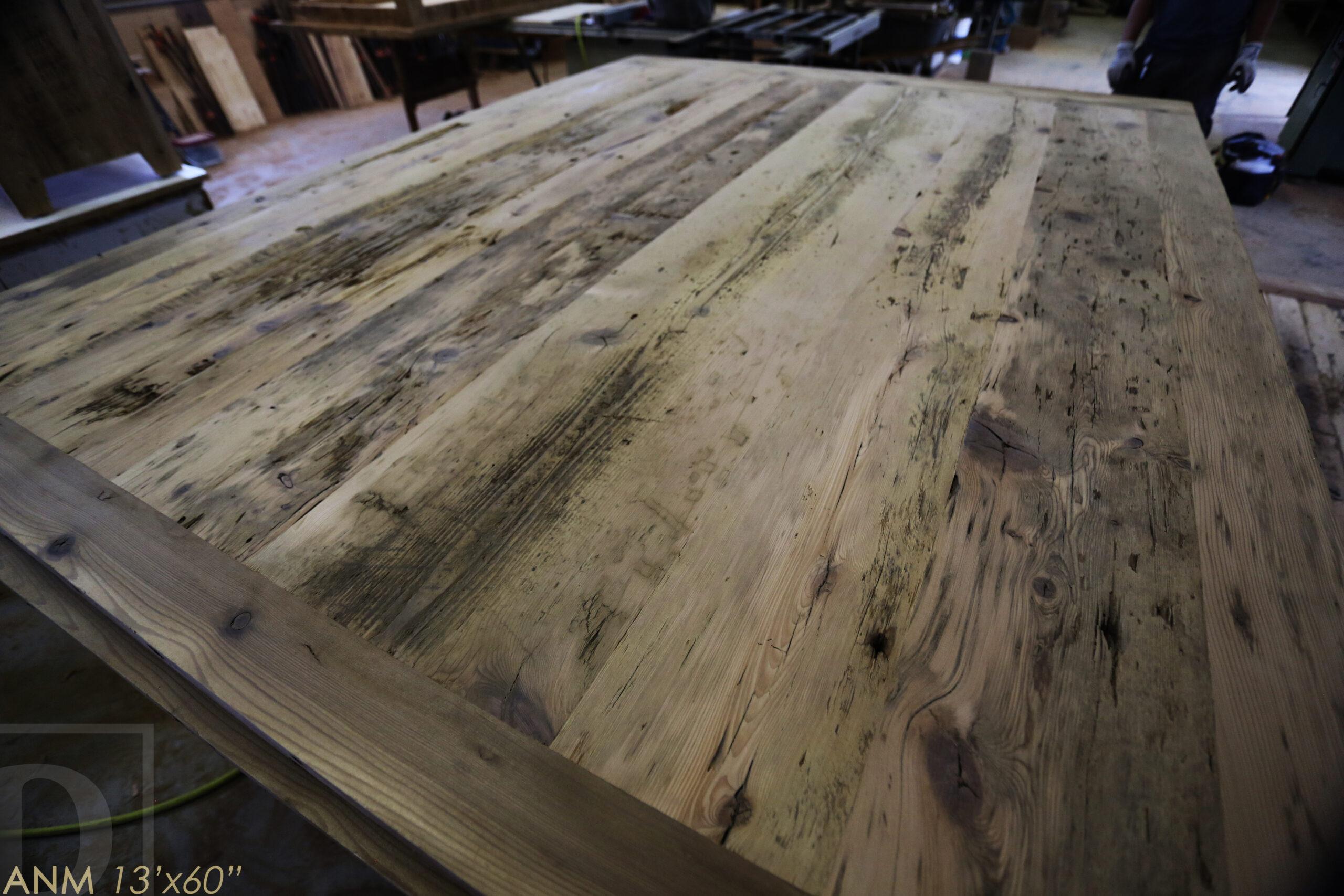 "13' Ontario Barnwood Boardroom Table we made for a Toronto company - 60"" wide - Matte Black U Shaped Metal Base - 2"" Hemlock Threshing Floor Top - Original edges & distressing maintained - Premium epoxy + satin polyurethane finish - www.table.ca"