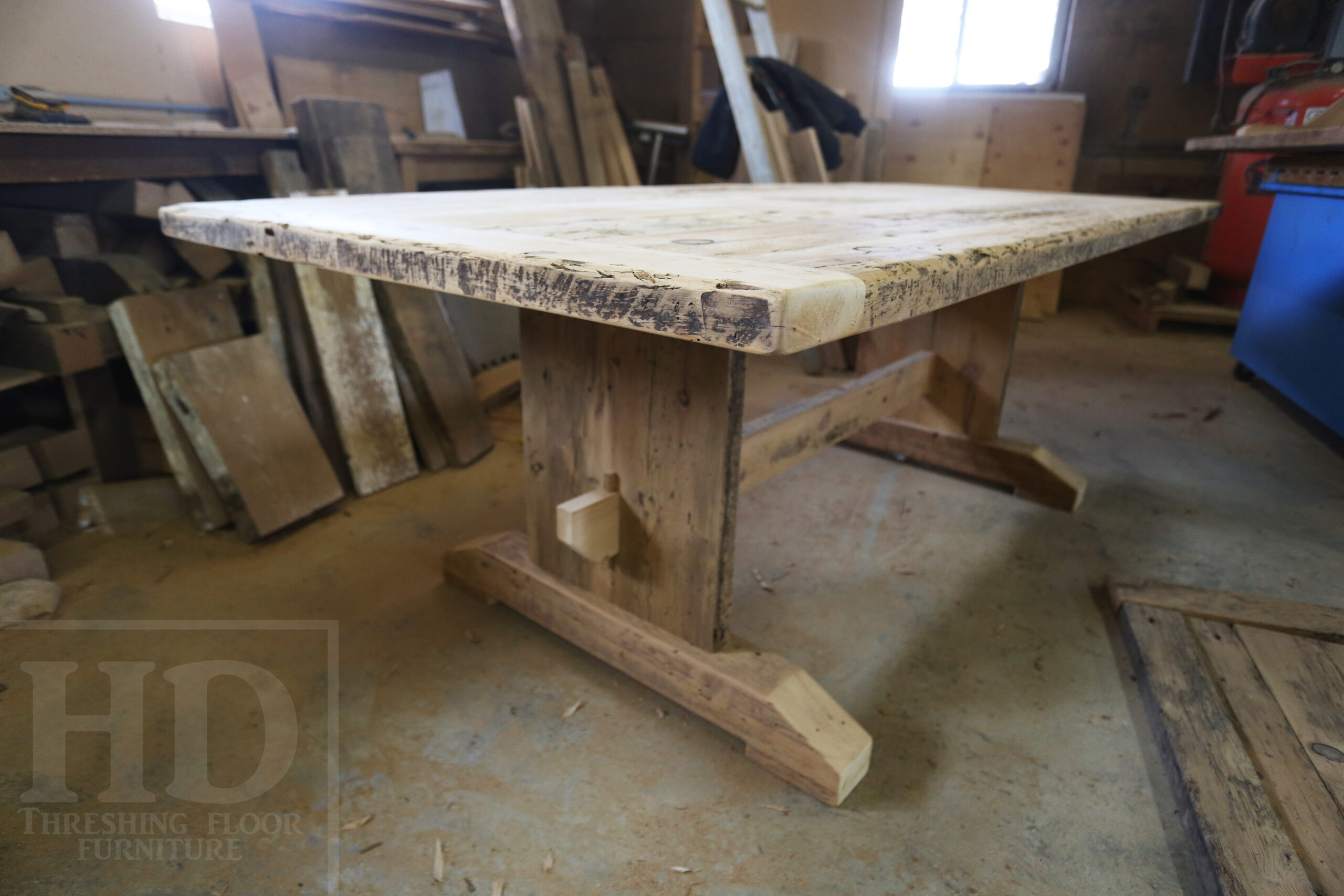 """7' Ontario Barnwood Table for a Grassie, Ontario Home - 42"""" wide - Trestle Base - Reclaimed Old Growth Pine Threshing Floor Construction - Original Distressing & Character & Edges Maintained - Premium epoxy + satin polyurethane finish - One 18"""" Leaf Extension - 7' [matching] Trestle Bench - 5 Wormy Maple Chairs - Stained to match table - www.table.ca"""