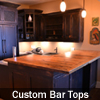 Custom basement bar top made from reclaimed barn floor boards